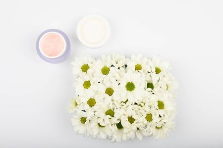 Naturally Cosmetics Concept. The concept of the usefulness of Flowers. on a white background top view. A place to write. Spa and living nature Reklamní fotografie