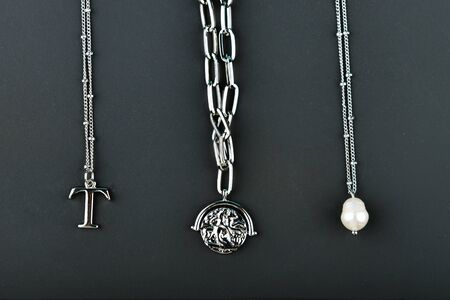 silver jewelery on a dark background. Jewelry for all lovers. View from above