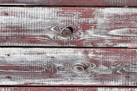 red-gray wooden background. horizontal boards. old paint peels off. old boards. Red gray wood texture of a worn painted board. Red gray wood texture of old worn painted board.