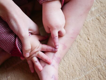The smeared feet of a child. baby's feet are smeared with mom's makeup. Stock fotó