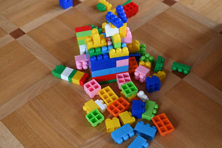childrens developing color constructor. scattered across the floor