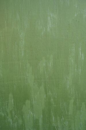 green metal background. poured paint. metal texture can be used as background. Banco de Imagens