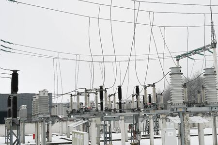 City electrical substation, close-up, transformer with high-voltage wires