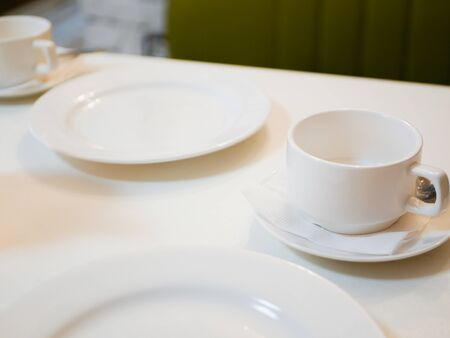 white dishes on a cafe table