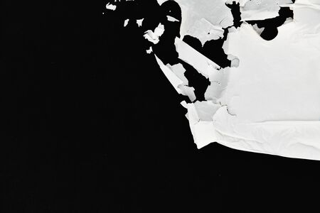 decaying polyethylene. white on a black background. view from above. place for writing. concept of pollution Stock Photo