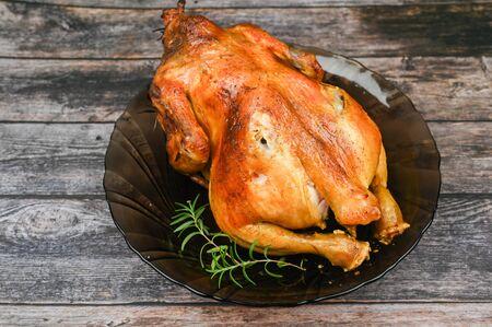 Baked chicken on wooden background. 版權商用圖片