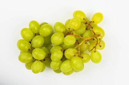 Large green juicy grape on a white background. Flat lay. view from above. Place for writing. A bunch of green grapes.