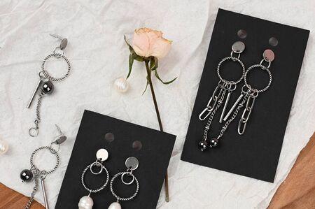flat lay of female earrings. Standard-Bild