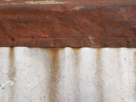 rusty iron on concrete. Rust flows onto concrete. Close-up. rusty metal sheet on concrete. Background. Place for writing
