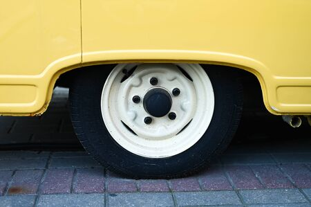 Wheel of a yellow van close-up. High quality photo Stock fotó