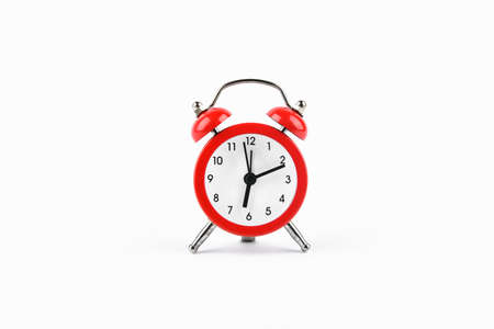 Red retro alarm clock on a white background. Round red alarm clock on a white background isolated. standard timer concept, warning of a change in time, retro signal of the beginning of the work of the clock of the end of the signal.