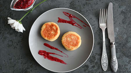 cheese pancakes on a gray plate marbled.