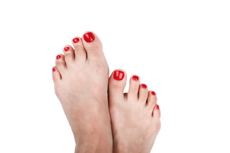spread your toes. with painted nails in red. on an isolated background