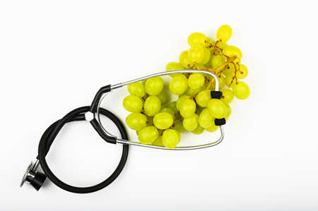 green grapes and health. on white background. view from above. A place to write. A bunch of green grapes. The concept of the usefulness of grapes Reklamní fotografie