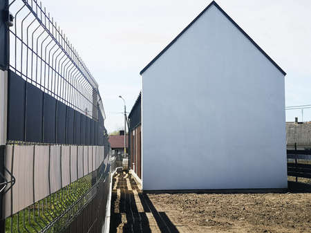 white house without windows. Empty house on the plot