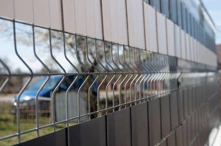 metal street fence. making a fence of metal residues Reklamní fotografie