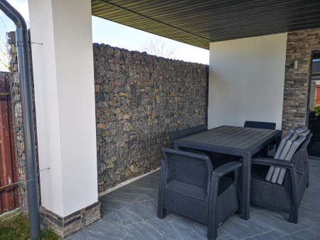 outdoor summer furniture near the stones Archivio Fotografico