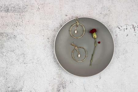 gold earrings in a plate.