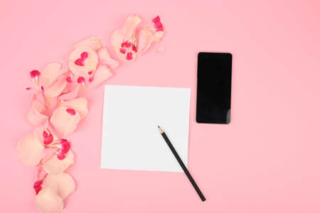 Wedding to do list with flowers on pink background. Floral mockup with paper card.