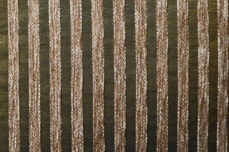 Striped beige green fabric texture.