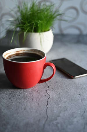 Morning coffee concept. Table with coffee machine and telephone
