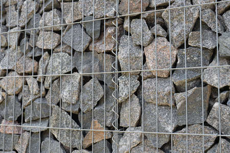 background of stones in a metal grid.