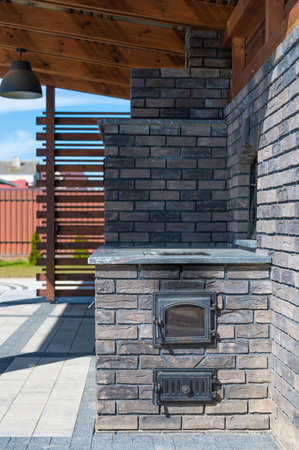 outdoor kitchen made of decorative bricks. for frying meat. Banque d'images