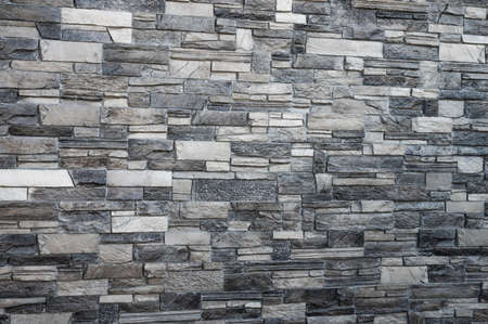 decorative gray wall laid out of tiles on a flat surface 스톡 콘텐츠