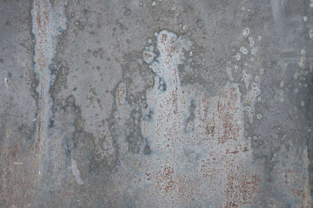 gray metal background with texture. poured paint. metal texture can be used as background