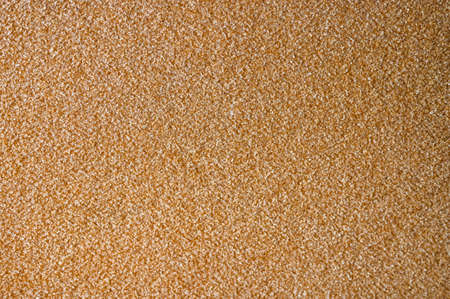 Yellow fabric texture with pimples.