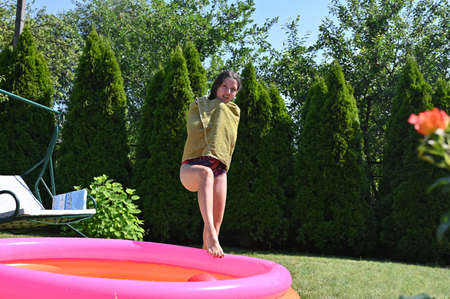 girl enters the inflatable pool