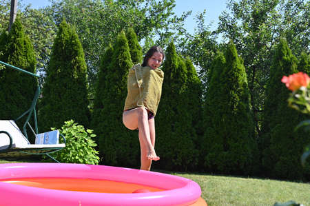 Girl and home inflatable pool Stock fotó