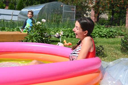 Girl and home inflatable pool