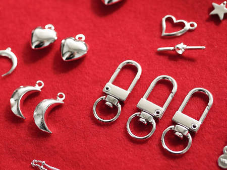Making jewelry from silver. on a red background. High quality photo