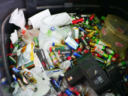 Barcelona, Spain - July 07, 2020. Spent batteries in a recycling bin. High quality photo