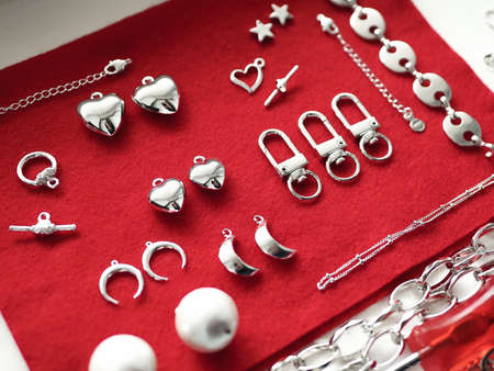 Silver jewelry on a red background. High quality photo