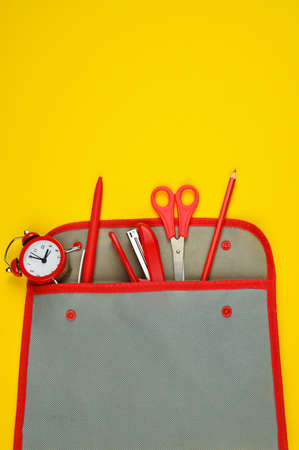 School supplies from a pencil case on a red-yellow background Reklamní fotografie