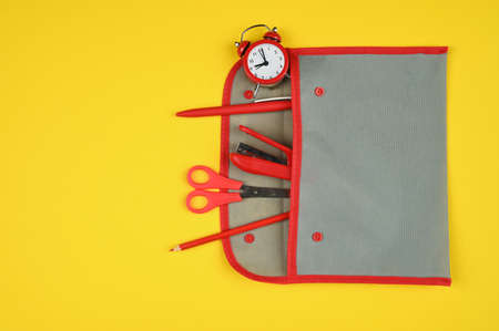 School supplies from a pencil case on a red-yellow background Reklamní fotografie - 151467678