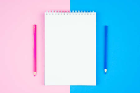 White notebook on a blue-pink background. sketchbook and pencil on pastel blue pink background. Top view, flat lay Reklamní fotografie - 151447700