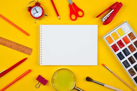 school supplies on a yellow background Reklamní fotografie - 151453985