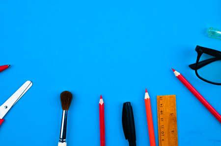 school supplies on a blue background Reklamní fotografie