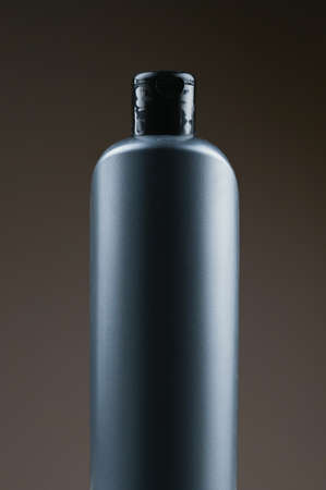 mockup of a gray plastic bottle on a dark background