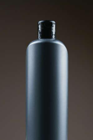 mockup of a gray plastic bottle on a dark background Reklamní fotografie - 153076342