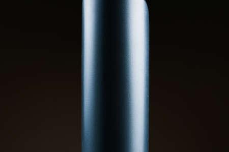 gray plastic bottle on black background Reklamní fotografie
