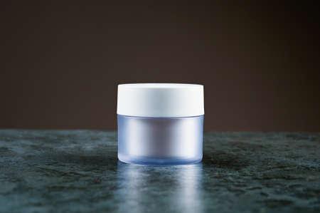mockup jars for cream on a dark background
