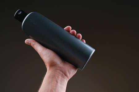 dark bottle mockup in hands