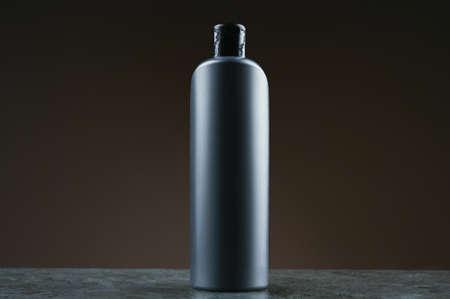 mockup of a gray plastic bottle on a dark background Reklamní fotografie - 153076366