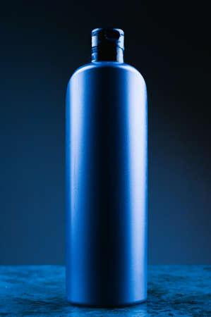 mockup of blue plastic bottle on dark background