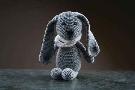 gray plush hare on a dark background Reklamní fotografie