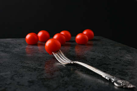 fork and tomatoes on a flat lay Reklamní fotografie - 153076378